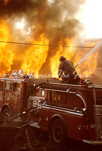 Engine Co. 24 operating their gun, protecting the exposures....