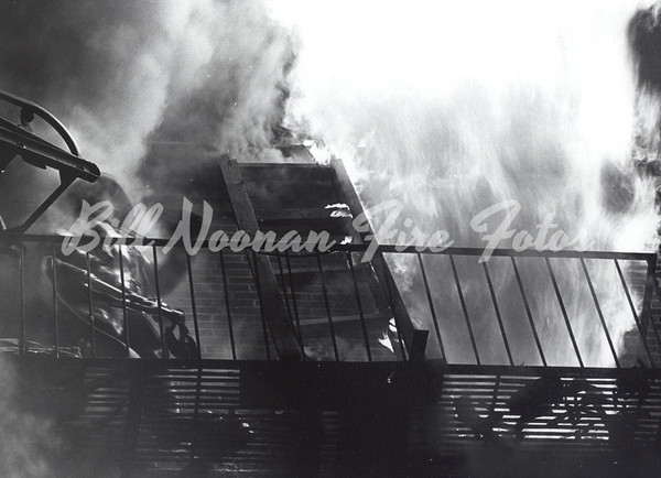 Firefighter from Engine Co. 37 calls for water in the line as heavy fire blows from the 3rd floor windows...one person dies in this 3 alarm fire on Appleton Street...