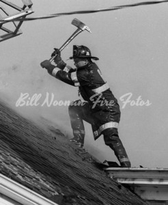 A one alarm fire in Jamaica Plain, a truckie from Ladder Co. 10 opens the roof....