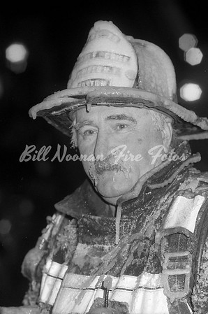 Firefighter covered with ice after a fire in East Boston...