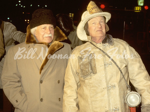 "January 1970...Arthur Fielder of the famous ""BOSTON POPS"" and a spark with Chief of Department Joseph Kilduff at a 3rd alarm on South Huntington Avenue...indeed it was a cold evening..."