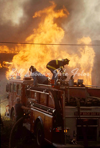 1981..in-fill housing, unfinished..came in as an outside fire...went to 6 alarms as occupied dwellings were scorched...Engine Co. 24 prepares their gun...