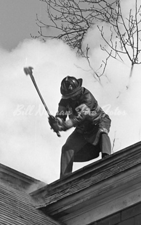 FF from Engine Co. 14 with an axe, must have been detailed to Ladder Co. 4 for the day...fire was a 2nd alarm, Spring 1977 I think...