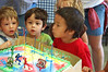 Rey blowing out his candles. Everything's a blur, but I love the faces on the two boys behind him.