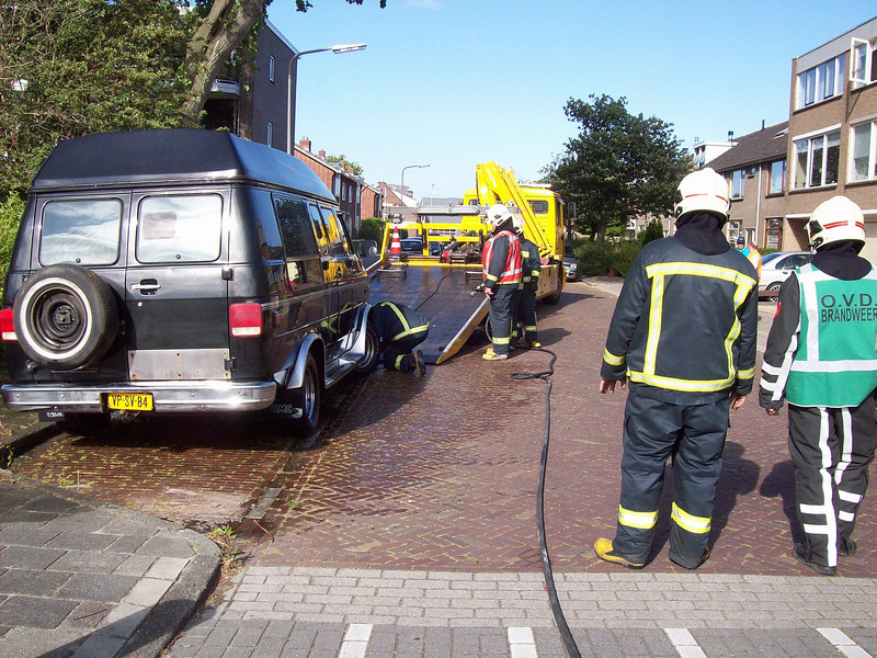 The GMC with leaking LPG tank being towed