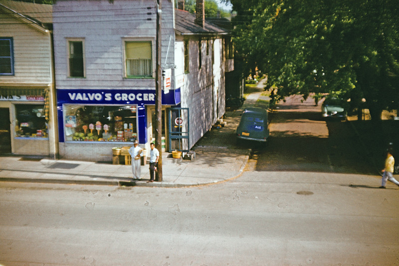 "My grandfathers grocery store in Dunkirk, NY.  Torn down now for urban renewal. Delivery truck parked alongside that says ""Ale"" on one door.  It used to say ""Beer"" on the other door before the accident."