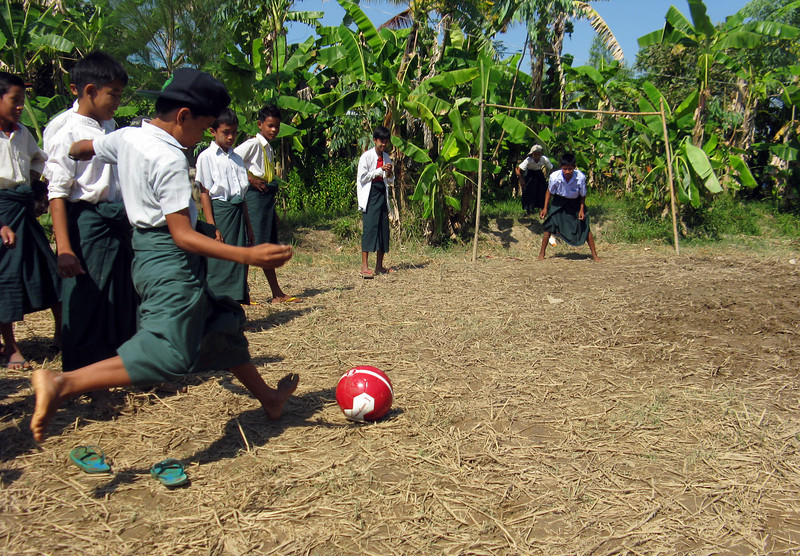 School kids trying out their new soccer ball