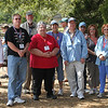 Most of our group pose for a picture at the Peach Orchard. Several have already spotted bluebirds perched on cannon out in the middle of the field.
