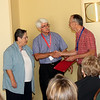 Dr. Pitts commends Judy and Bob Peak after Bob's informative presentation.