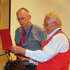 Dr. Pitts, who later presented similar Certificates of Appreciation to several other speakers, here receives one himself following his tribute to Mrs. Laskey. .