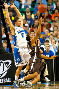 B.J. Bailey (right) of Lehigh is bumped by Austin Rivers (left) of Duke on a layup attempt, during the Second Round of the NCAA National Tournament at Greensboro Coliseum in Greensboro, NC on Friday, March 16, 2012.  #15 seeded Lehigh upset #2 Duke to advance on to the Third Round.
