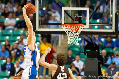 Mason Plumlee (left) of Duke throws down a thunderous jam during the Second Round of the NCAA National Tournament at Greensboro Coliseum in Greensboro, NC on Friday, March 16, 2012.  #15 seeded Lehigh upset #2 Duke to advance on to the Third Round.