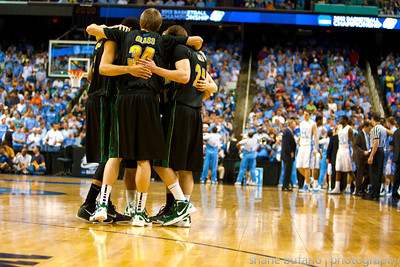 The Vermont Catamounts starters huddle up before tip-off against North Carolina during the Second Round of the NCAA National Tournament at Greensboro Coliseum in Greensboro, NC on Friday, March 16, 2012.