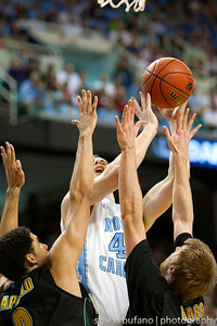 Tyler Zeller (center) of North Carolina is double teamed by Vermont's Luke Apfeld (left) and Matt Glass (right) during the Second Round of the NCAA National Tournament at Greensboro Coliseum in Greensboro, NC on Friday, March 16, 2012.