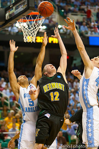 Sandro Carissimo (center) of Vermont splits the North Carolina defense as he scores a reverse layup during the Second Round of the NCAA National Tournament at Greensboro Coliseum in Greensboro, NC on Friday, March 16, 2012.