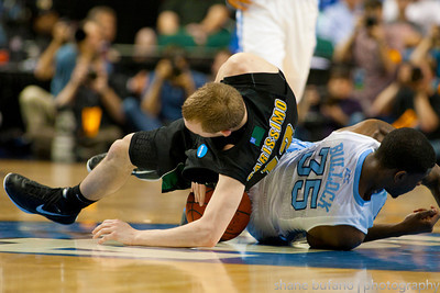 Sandro Carissimo (left) of Vermont and Reggie Bullock (right) of North Carolina fight for a loose ball, during the Second Round of the NCAA National Tournament at Greensboro Coliseum in Greensboro, NC on Friday, March 16, 2012.