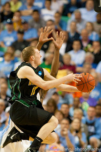 All eyes from the crowd are on Sandro Carissimo as he attempts a layup for Vermont during the Second Round of the NCAA National Tournament at Greensboro Coliseum in Greensboro, NC on Friday, March 16, 2012.