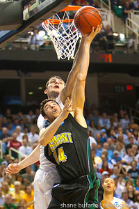 Josh Elbaum (14) of Vermont has his shot blocked by Tyler Zeller (top) of North Carolina during the Second Round of the NCAA National Tournament at Greensboro Coliseum in Greensboro, NC on Friday, March 16, 2012.