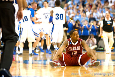 Trevor Releford of Alabama lays on the floor after missing a game winning three pointer as the Crimson Tide are ousted by Creighton who celebrates behind him, during the Second Round of the NCAA National Tournament at Greensboro Coliseum in Greensboro, NC on Friday, March 16, 2012.