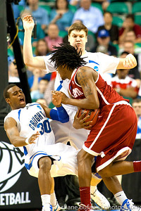 Antoine Young (30) of Creighton draws a charge on Levi Randolph (right) of Alabama, during the Second Round of the NCAA National Tournament at Greensboro Coliseum in Greensboro, NC on Friday, March 16, 2012.