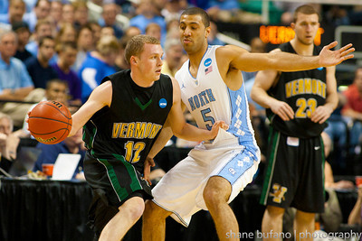 Sandro Carissimo (12) tries to run the offense for Vermont as he is defended by North Carolina's Kendall Marshall (5) during the Second Round of the NCAA National Tournament at Greensboro Coliseum in Greensboro, NC on Friday, March 16, 2012.