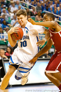 Grant Gibbs (10) of Creighton drives past Trevor Releford of Alabama (right) during the Second Round of the NCAA National Tournament at Greensboro Coliseum in Greensboro, NC on Friday, March 16, 2012.