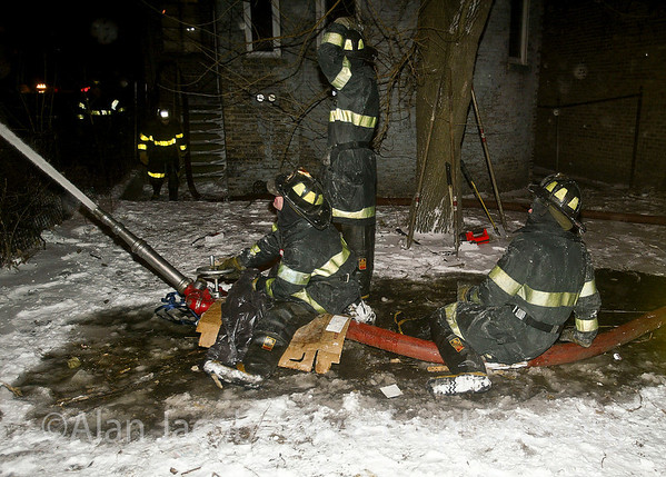 "A cold night... 311 alarm, 2121 W. Washington, 2/11/03<br /> 10°, 20 mph sustained wind for 6 hours. <br /> This piece of equipment is called a ""multiversal"" . A 2 1/2 inch line is connected, sometimes 2 lines are used, enabling more water and higher pressure, thus throwing the stream a greater distance.A cold night... 311 alarm, 2121 W. Washington, 2/11/03<br /> 10°, 20 mph sustained wind for 6 hours. edit"