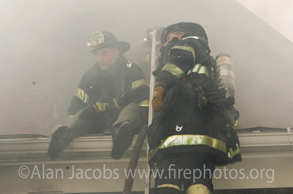 How they are able to stand the smoke is beyond my comprehension. Box Alarm, 10/30/06 in Chicago's Bridgeport.
