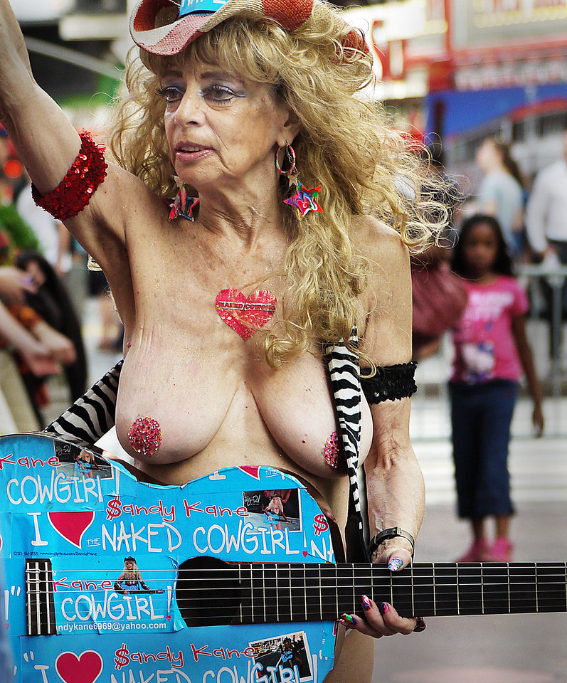 Where but in Times Square? New York's Naked Cowgirl- She didn't have a hat for collections- you had to put it in a rubberband around her leg-.. I didn't..........