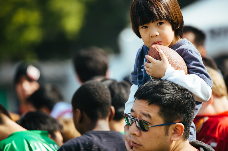 November 16 - A young fan and his father line up to meet Joe Montana at a football clinic in Shanghai (NFL China)