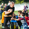 November 16 - Joe Montana gets tackled by youth football players in Shanghai (NFL China)