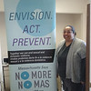 Womanshelter/Companeras educator Carmen Nieves is psyched to show off the new No More pop=up banner!