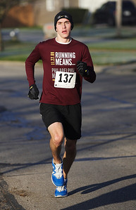 Aaron Apathy has a a commanding lead of more than 1 minute thirty seconds as he nears the end of the race. The 27 year old Westlake resident won first place overall with a time of 16:23.4 in the 5k race. Photo by Ray Riedel