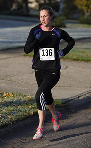 Rochelle Morgan of Peninsula was the first female finisher and third place overall with a time of 18:39.8 in the 5k race. Photo by Ray Riedel