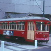 A New Orleans streetcar makes the Hilton River Walk stop.  12/1989.  Photo & caption by Brendan Brosnan
