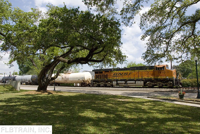 BNSF 109 car manifest east running on UP trackage rights under the live oaks through Plaquemine, LA.  Leading the train is ES44DC 7410.  4/9/2011, 1:35 PM.  Photo by Forrest Becht during a Chapter outing.