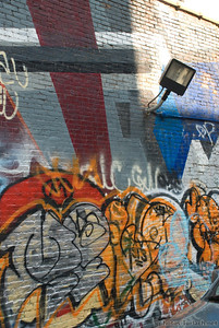 A wall covered in some creative graffiti in New York City.
