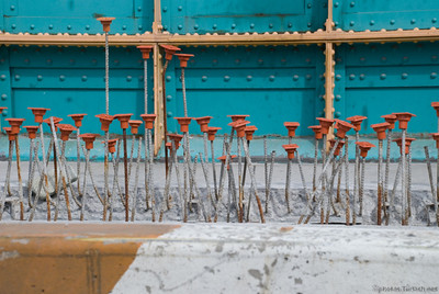 Metal Rods with tops -This construction scene reminds me of a flower bed.