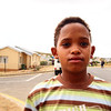 Boy on Corner in Otjimusie, Namibia.