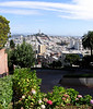 The windiest street in the world--Lombard Street--overlooking Coit Tower and the city of San Francisco.