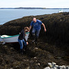 NASH ISLAND, Maine -- 05/17/2017 - Evie Wakeman (left), 15, helps her dad, Alfie Wakeman, bring their row boat to shore on Little Nash Island Wednesday. The family takes care of approximately 150 sheep spread between Little and Big Nash Islands. Ashley L. Conti | BDN