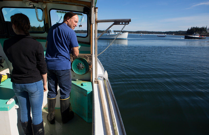 NASH ISLAND, Maine -- 05/17/2017 - Alfie Wakeman (right) navigates his boat from the public landing in Addison with his daughter Evie, 15, Wednesday. The family looks after approximately 150 sheep spread between Little and Big Nash Islands. Ashley L. Conti | BDN