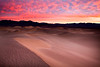 Sunrise spills over on the Mesquite Sand Dunes in Death Valley National Park