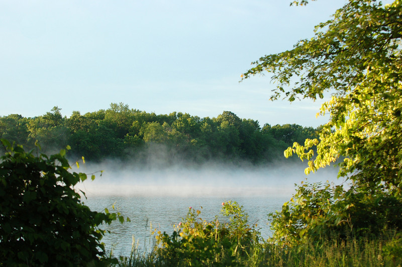Among the Beaver Islands, morning mist rises off the river.