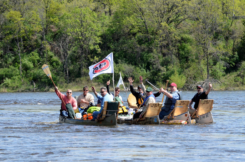 An alumni group floats down the Mississippi.