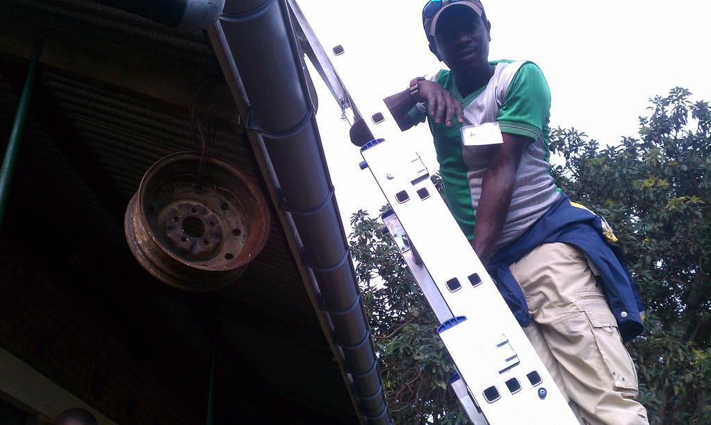 Our main man Jados. The wheel is a school bell. Fairly standard item on schools in Rwanda.