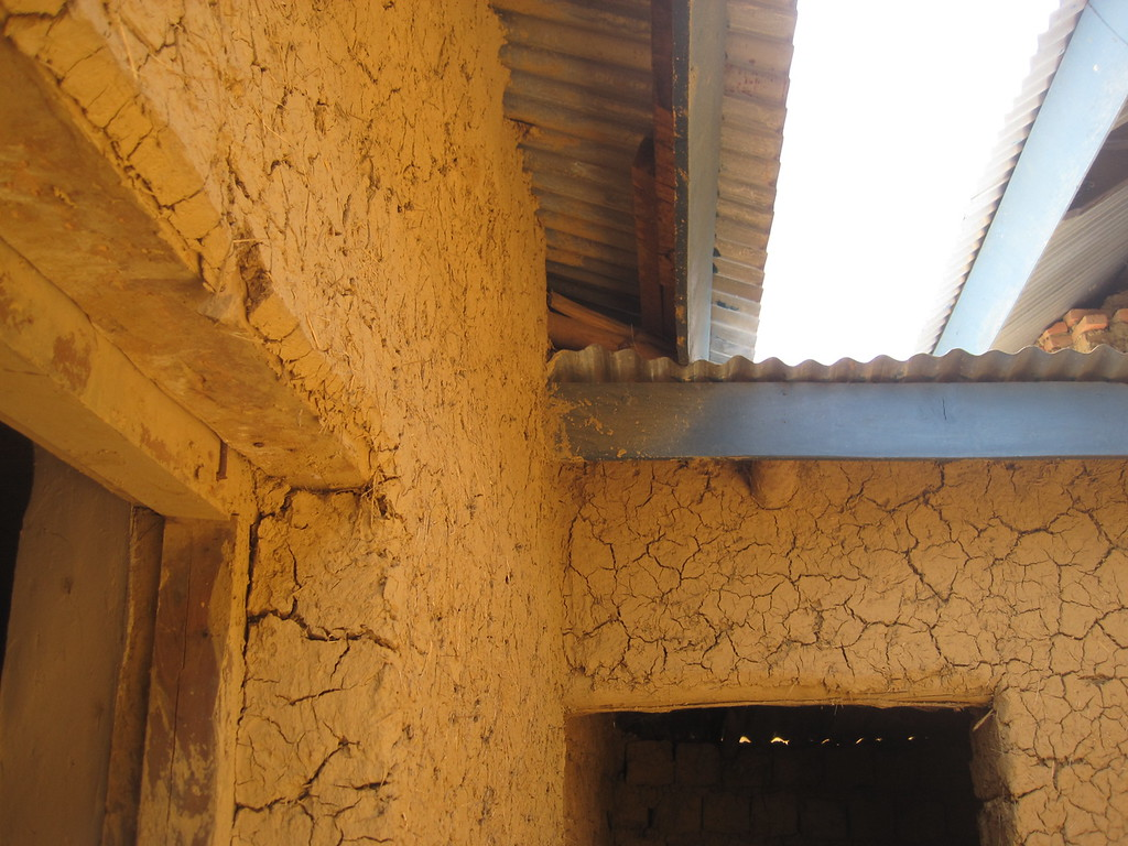 This detail shows the existing fascia board and roof edge.