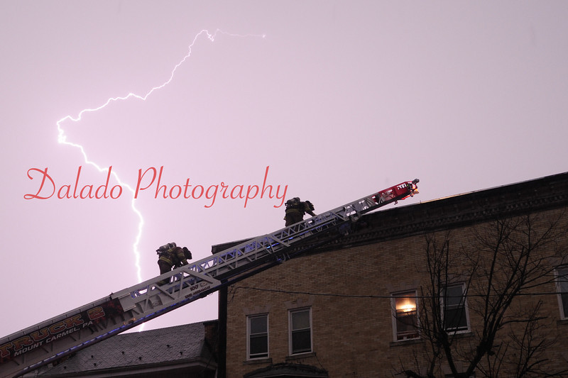 Lightning striking near firefighters.