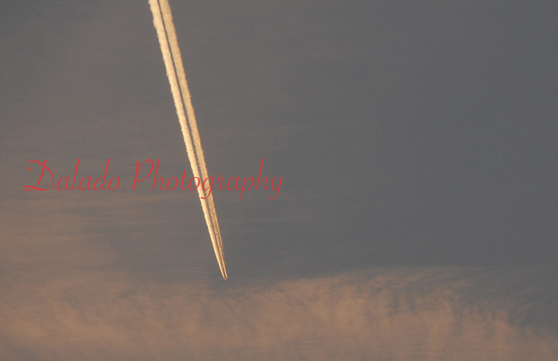 A contrail passes through the sky above Interstate 81.