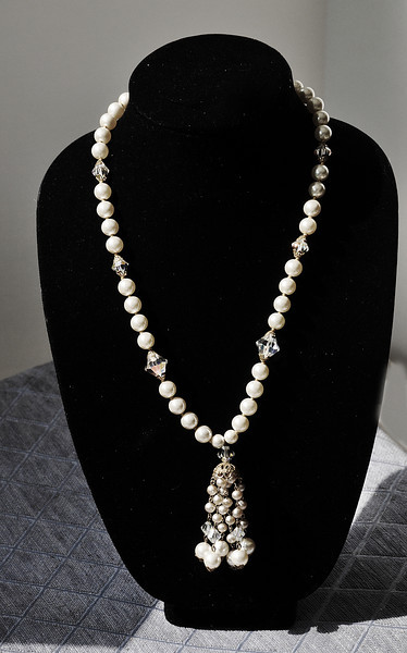 "Necklace is approx 14"" long without the adjustment piece, which is and additional 3 "".  The 7 crystals are gorgeous, sparkly and  6 are smaller than the two that are at the beginning of the necklace.  The pearls are creamy white..no pink.   The tassels also have crystals that are beautiful.<br /> Necklace is in excellent condition.  wt: 53 grams"